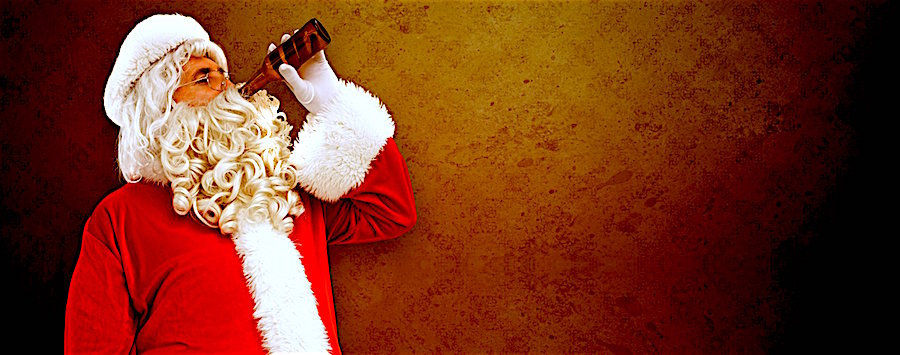 Composite image of father christmas drinking a beer